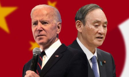 Joe Biden and Yoshihide Suga in front of a Chinese flag